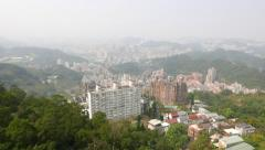 City district aerial view, mountain side, forest on foreground. - stock footage