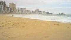 City skyline and beach Stock Footage