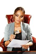 Businesswoman looks on document Stock Photos