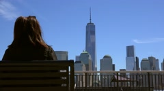 Girl admires the view of Manhattan from the J. Owen Grundy Park at Jersey City. Stock Footage