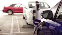 Pan Up Electric Vehicle Recharging Stock Footage
