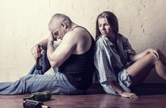 Young couple in the fight against alcoholism sitting on the floor Stock Photos