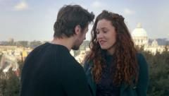 Young lovers joke and flirt with the dome of Saint Peter in the background Stock Footage