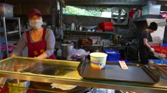 POV chinese eatery, cook woman puts oyster omelette plate to tray Stock Footage