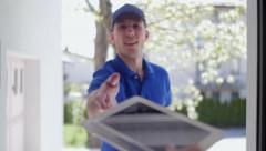 Delivery guy customer POV rack focus Stock Footage