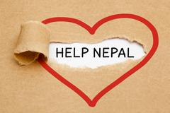 Help Nepal Torn Paper - stock photo