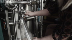 Man pours beer brewery labaratory close up Stock Footage