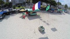 Kiosk beach with Brazil and France flag in Rio de Janeiro Beach Stock Footage