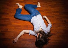 Lying on the floor of a lonely young woman in a empty room Stock Photos