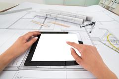 Draftsman Hands With Blank Digital Tablet Over Blueprint In Office. Blueprint - stock photo