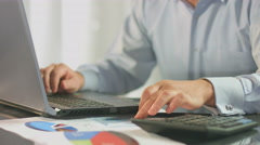 Accountant calculating, inserting data in report, business plan Stock Footage