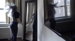 Lady Whipping Hair Back - Girl Pulling Ponytail in Mirror Woman Bedroom 4K - stock footage