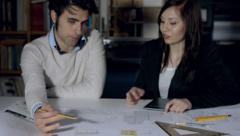 Architect teamwork: people discussing about the blueprint and checking it Stock Footage