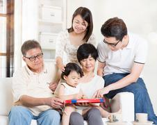 Grandparents having fun with offsprings - stock photo