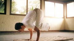 Hispanic man doing yoga Stock Footage