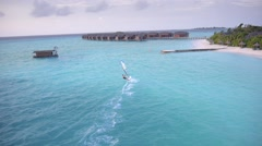 Aerial view of the surfer enjoying at beautiful Maldives Stock Footage