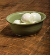 Bowl of peeled hard boiled eggs - stock photo