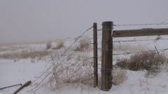 Spring snow covers a remote and deserted country road. - stock footage