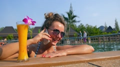 Young Woman Talking on the Phone in Pool. Slow Motion - stock footage