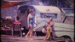 2032 - family & friends camping at the beach - vintage film home movie Stock Footage