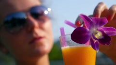 Female in Sunglasses Drinking Fresh Fruit Juice on Vacation Stock Footage