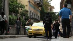 Taxi in the street with tourist people walking around Stock Footage