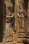 Apsara dancers decorate Angkor Wat - stock photo