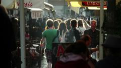 Tourist people walking in the street at sunset in Athens: tourism, shopping Stock Footage