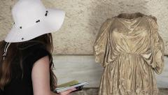 Beautiful Woman Looking At statue In a Museum - stock footage