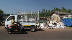 Truck leaving after unloading sacks with waste at the disposal place. Stock Footage