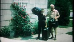 2037 - family members carry what they need for vacation -vintage film home movie Stock Footage