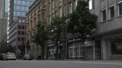 ULTRA HD 4K Traffic street car pass Frankfurt downtown business center day icon Stock Footage