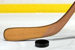 Ice hockey stick and puck on rink - stock illustration