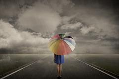 Woman Walking Alone On Rainy Day Stock Photos