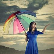Woman Check If The Rain Stop - stock photo