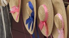 Colonial Williamsburg Virginia historic woman straw hats breeze 4K 039 Stock Footage