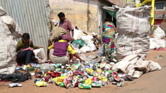 Women and men sorting waste at a street disposal place in Goa. Stock Footage