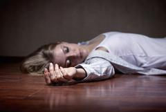 Corpse. The dead woman's body. Focus on hand - stock photo