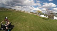 2.7k aerial drone films guy on dirtbike in backyard Stock Footage