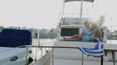 Enamoured man and woman. A romantic travel by the ship Stock Footage