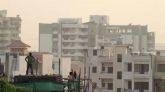 Workers at a Rapid Metro construction site, part of Delhi Metro, Gurgaon Stock Footage