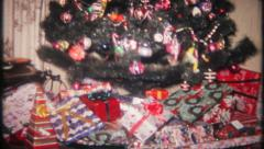 2042 - classic Christmas tree with gifts all around - vintage film home movie - stock footage