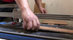 worker cut tile with professional cutter. Renovation work tool. - stock footage