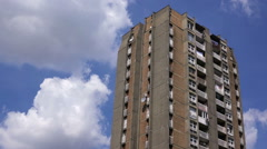 Old Residential Building Skyscrapers with Blue Summer Sky and White Clouds Stock Footage