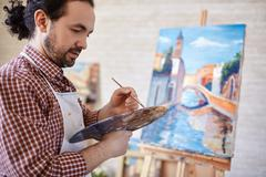 Artist with palette - stock photo