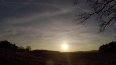 Time lapse; Sunset in the countryside with light clouds Stock Footage