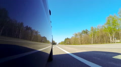 Driving a car. The camera is outside and aimed back. Stock Footage