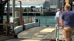 Passengers load onto chappy ferry Stock Footage