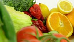 Healthy food - vegetables and fruits - white background studio - closeup Stock Footage
