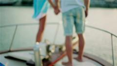 The guy with the girl on the stern of the vessel Stock Footage